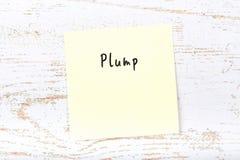 Gelbe klebrige Anmerkung mit dem handgeschriebenen Wort prall stockfoto