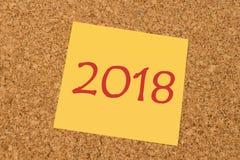Gelbe klebrige Anmerkung - neues Jahr 2018 Stockfoto