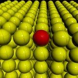 Gelbe Kugeln des Stoßes 3d mit einzelner roter Kugel Stockbild