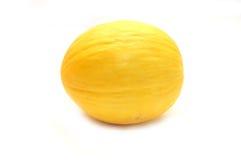 Gelbe Melone auf einem weißen Hintergrund Lizenzfreie Stockfotografie
