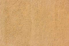 Gelbe oder orange Betonmauerbeschaffenheit als Hintergrund Stockbild