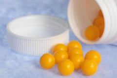 Gelbe Pillen Lizenzfreie Stockfotografie