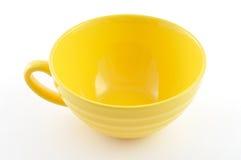 Gelbe Platte auf weißem Hintergrund Lizenzfreie Stockfotos