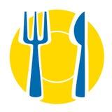Gelbe Platte mit blauer Gabel und Messer Lizenzfreies Stockfoto