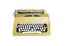 Gelbe schmutzige Retro- Schreibmaschine mit dem Beschneidungspfad lokalisiert auf whi Lizenzfreie Stockfotos