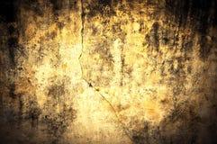 Gelbe schmutzige Wandbeschaffenheit Stockfotos