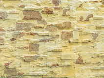Gelbe Steinwand Stockbilder