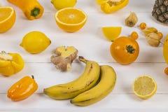 Gelbe und orange Frucht Stockbilder