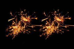 Gelbe und rote funkelnde Feuerwerke Stockbild
