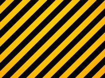 Gelbe und schwarze diagonale Gefahrstreifen Lizenzfreie Stockfotos