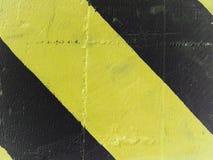 Gelbe und schwarze Streifen Stockbild