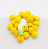Gelbe und weiße Tablette Stockbild
