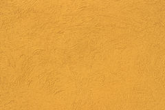 Gelbe Wand des Betons mit Stockfotos