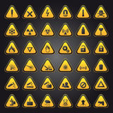 Gelbe WARNING- und Gefahrenzeichen Stockfoto