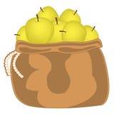 Gelber Apfel in der Tasche Stockfotos