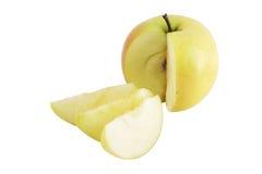 Gelber Apfel und Scheiben Stockbild