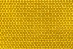 Gelber Bienenwabehintergrund Lizenzfreie Stockfotografie