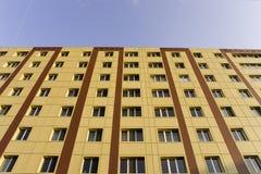 Gelber Gebäude-Hintergrund Stockfoto