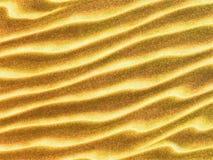 Gelber gewellter Sandbereich als Hintergrund Lizenzfreies Stockbild