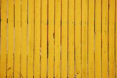 Gelber hölzerner Zaun-Hintergrund Stockfoto