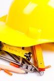 Gelber Hardhat und Hilfsmittel Stockfotos
