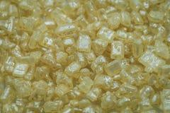 Gelber Kristall besprüht stockbild