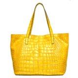Gelber lederner weiblicher Luxuxbeutel getrennt auf Weiß Stockbild