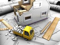 Gelber LKW und Modell des Hauses Stockbilder