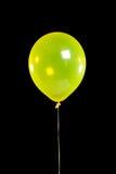 Gelber Partyballon auf Schwarzem Stockbilder