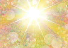 Gelber Porträthintergrund mit starburst Licht und bokeh Stockfoto