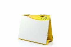 Gelber Schreibtisch-Spiralenkalender des leeren Papiers Lizenzfreies Stockbild