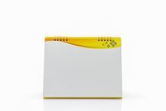 Gelber Schreibtisch-Spiralenkalender des leeren Papiers Stockfotografie