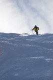 Gelber Skifahrer Stockfotografie
