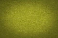 Gelber Stoffbeschaffenheit Hintergrund mit schwarzer Steigungsvignette Stockfotografie