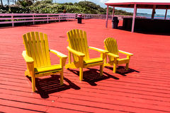 Gelber Strand Adirondack-Stuhl Lizenzfreie Stockbilder