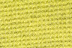 Gelber Tischdeckenbeschaffenheitshintergrund, Abschluss oben Stockfoto