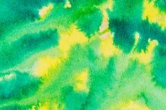 Gelber und grüner farbiger Tintenwäschehintergrund Lizenzfreie Stockfotografie