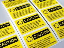 Gelber Vorsichtaufkleber, Standardvorsichtaufkleber mit Text stockfotografie