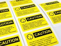 Gelber Vorsichtaufkleber, Standardvorsichtaufkleber mit Text stockfotos