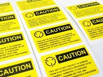 Gelber Vorsichtaufkleber, Standardvorsichtaufkleber mit Text lizenzfreie stockbilder