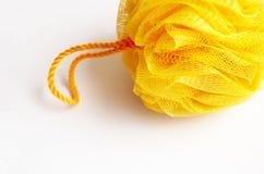 Gelber Washcloth für Hygiene Stockfotografie