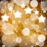 Gelber Weihnachtshintergrund mit Sternen Stockbild