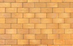 Gelber Ziegelsteingehweg des Hintergrundes Stockfoto