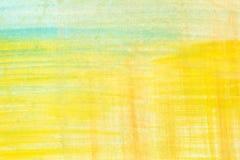Gelbes abstraktes Aquarell malend gemasert auf Weißbuchhintergrund Stockfoto
