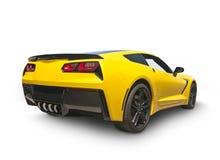 Gelbes amerikanisches Sport-Auto lokalisiert auf Weiß Lizenzfreie Stockfotos