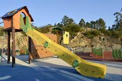 Gelbes Dia in einem Spielplatz Lizenzfreie Stockbilder