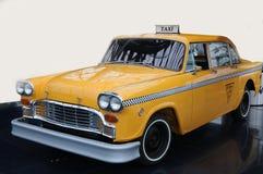 Gelbes Fahrerhaustaxi Stockbild
