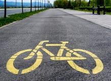 Gelbes Fahrradzeichen Lizenzfreie Stockfotografie