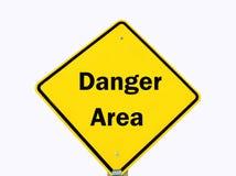 Gelbes Gefahrenzeichen getrennt Stockbild