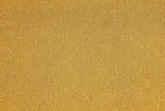 Gelbes Goldlack mit funkelnden Flocken Stockbilder